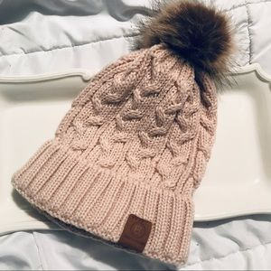 Tan beanie with fur pompon